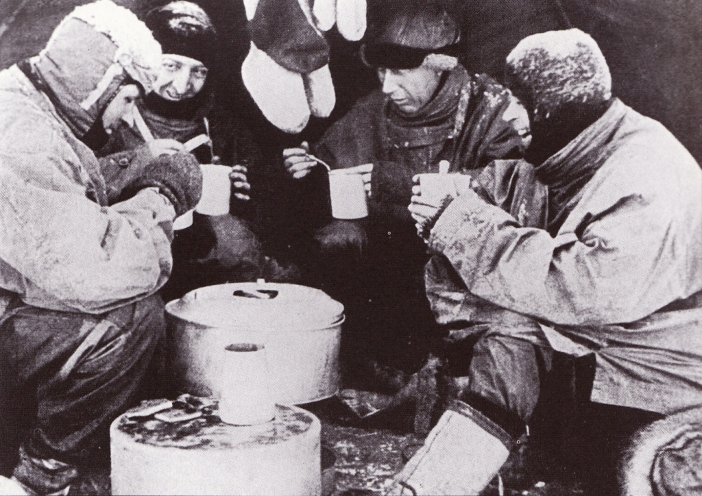 Mealtime during the Terra Nova Expedition. From left to right Evans, Bowers, Wilson and Scott